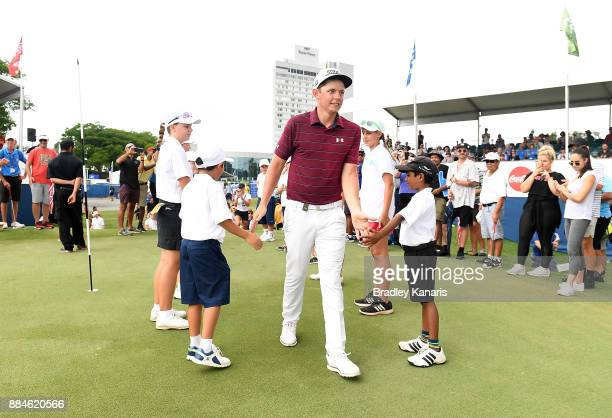 Cameron Smith of Australia is given a guard of honour by junior golfers after winning the 2017 Australian PGA Championship at Royal Pines Resort on...
