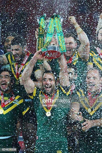 Cameron Smith of Australia lifts the trophy with team mates after victory in the Four Nations Final between New Zealand and Australia at Anfield on...