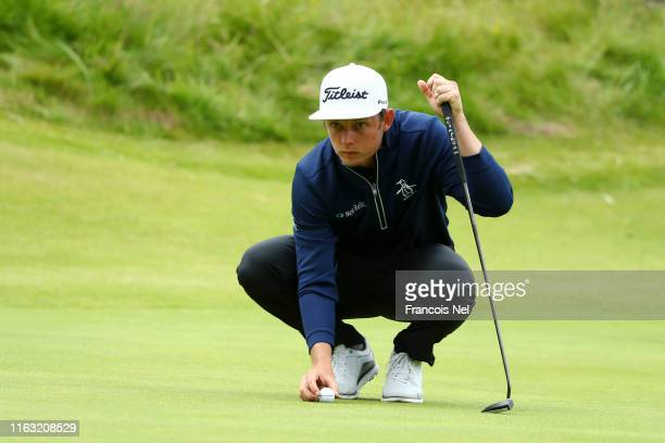 Cameron Smith of Australia lines up a putt during the third round of the 148th Open Championship held on the Dunluce Links at Royal Portrush Golf...