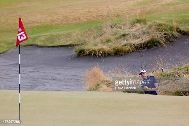 Cameron Smith of Australia plays a bunker shot on the 13th hole during the first round of the 115th US Open Championship at Chambers Bay on June 18...