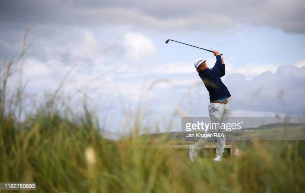 Cameron Smith of Australia plays his shot from the sixth tee during the first round of the 148th Open Championship held on the Dunluce Links at Royal...