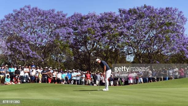 TOPSHOT Cameron Smith of Australia putts on a green during the second round of the Australian Open at the Australian Golf Club course in Sydney on...