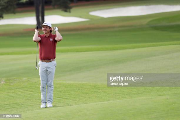Cameron Smith of Australia reacts to his shot on the 18th hole during the final round of the Masters at Augusta National Golf Club on November 15,...