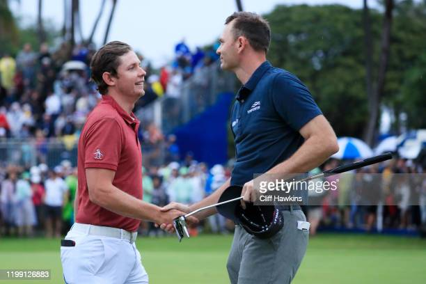 Cameron Smith of Australia shakes hands with Brendan Steele of the United States on the 18th green prior to their playoff during the final round of...