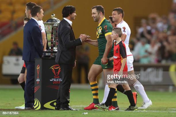 Cameron Smith of Australia shakes hands with Jonathan Thurston during the 2017 Rugby League World Cup Final between the Australian Kangaroos and...