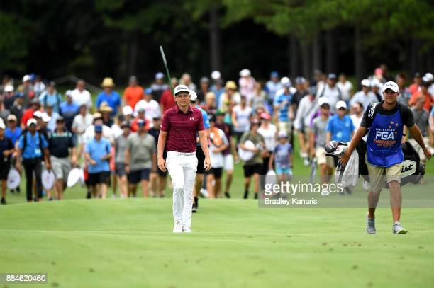 Cameron Smith of Australia walks down the 18th hole as the crowd gathers behind him during day four of the 2017 Australian PGA Championship at Royal...