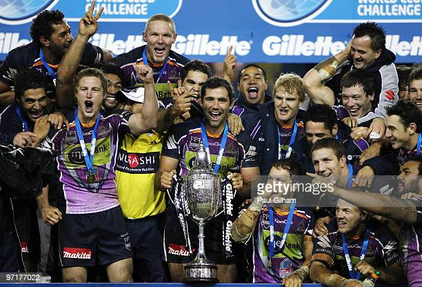 Cameron Smith of Melbourne Storm and his teammates celebrate with the winners trophy after winning the World Club Challenge match between Leeds...