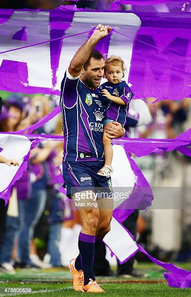 Cameron Smith of Storm runs onto the field to celebrate becoming the most capped Storm player of all time during the round two NRL match between the...