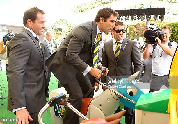 Cameron Smith of the Australian Kangaroos plays on a horse racing video game after the Victoria Derby Barrier Draw at Crown Entertainment Complex on...