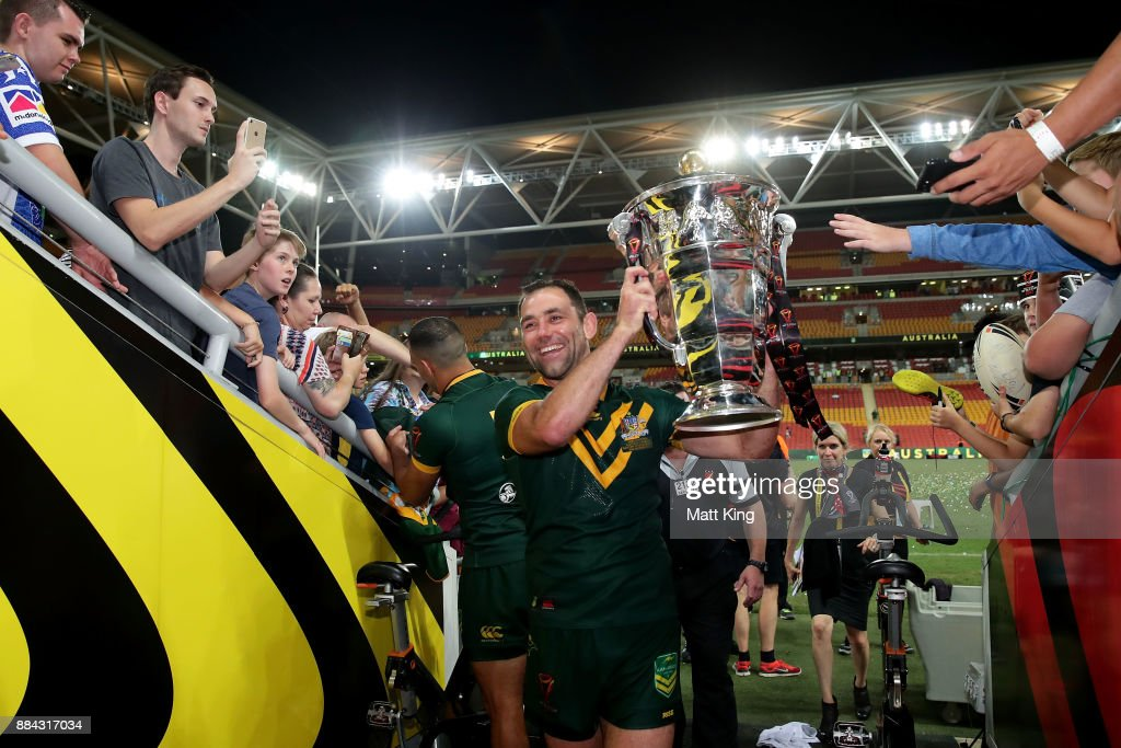 Cameron Smith of the Kangaroos holds aloft the Rugby League World Cup Trophy after winning the 2017 Rugby League World Cup Final between the Australian Kangaroos and England at Suncorp Stadium on December 2, 2017 in Brisbane, Australia.