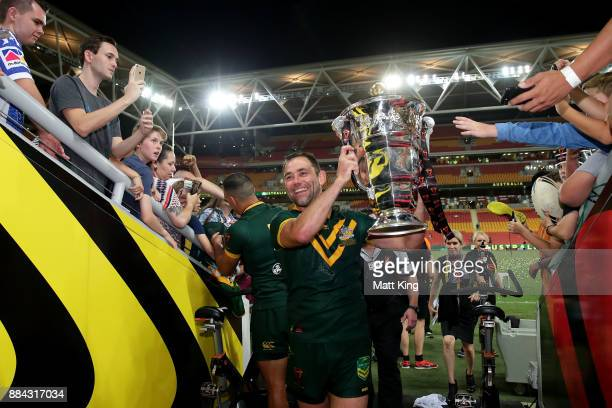 Cameron Smith of the Kangaroos holds aloft the Rugby League World Cup Trophy after winning the 2017 Rugby League World Cup Final between the...