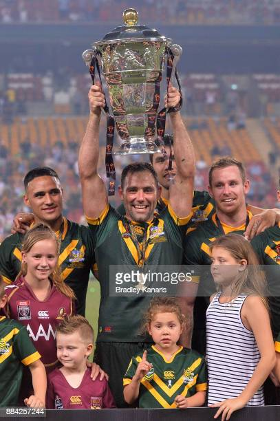 Cameron Smith of the Kangaroos holds aloft the trophy after winning the 2017 Rugby League World Cup Final between the Australian Kangaroos and...