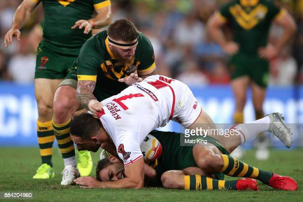 Cameron Smith of the Kangaroos is tackled by Luke Gale of England as Josh McGuire of the Kangaroos comes in for support during the 2017 Rugby League...