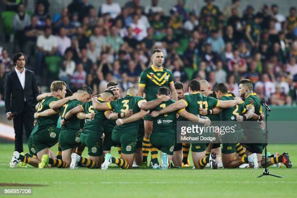 Cameron Smith of the Kangaroos stands up to face the England players during the 2017 Rugby League World Cup match between the Australian Kangaroos...