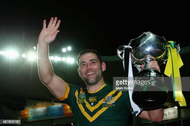 Cameron Smith of the Kangaroos waves to the crowd as he celebrates victory during the ANZAC Test match between the Australian Kangaroos and the New...