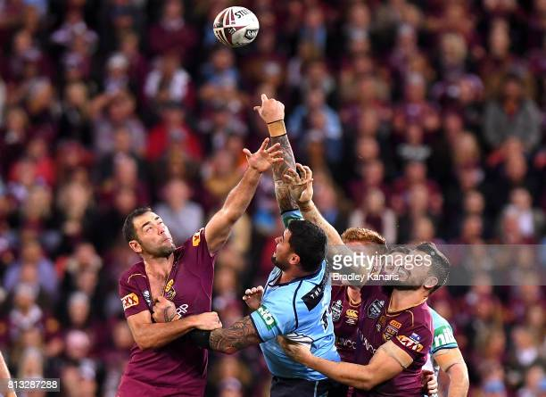 Cameron Smith of the Maroons and Andrew Fifita of the Blues challenge for the ball during game three of the State Of Origin series between the...