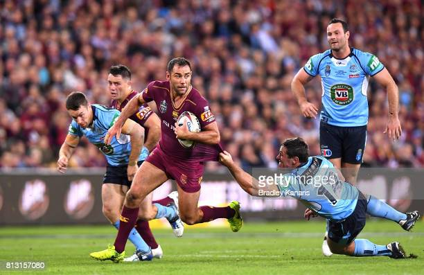 Cameron Smith of the Maroons breaks away from the defence during game three of the State Of Origin series between the Queensland Maroons and the New...