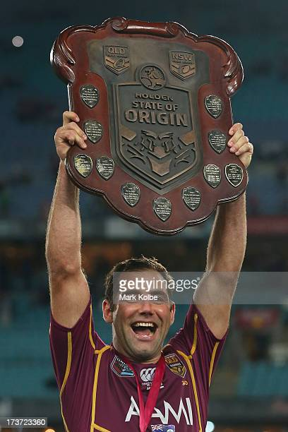 Cameron Smith of the Maroons celebrates as he lifts the shield after victory in game three of the ARL State of Origin series between the New South...