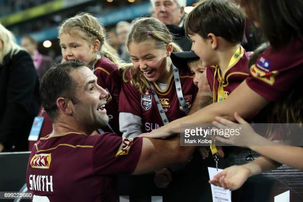 Cameron Smith of the Maroons clebrates with family in the crowd after victory during game two of the State Of Origin series between the New South...
