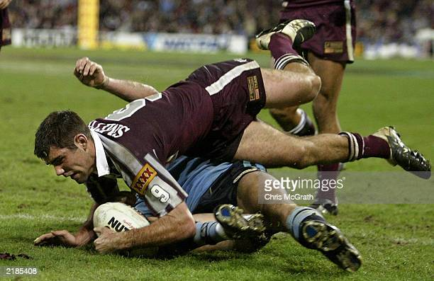 Cameron Smith of the Maroons crosses to score a try during game three of the NRL State of Origin Series between the Queensland Maroons and the New...