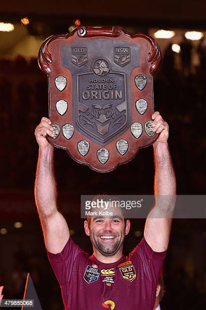 Cameron Smith of the Maroons holds up the State of Origin shield as he celebrates victory after game three of the State of Origin series between the...