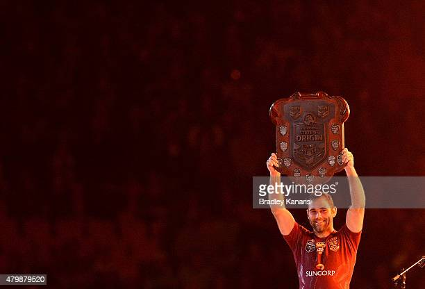 Cameron Smith of the Maroons holds up the winners shield after game three of the State of Origin series between the Queensland Maroons and the New...