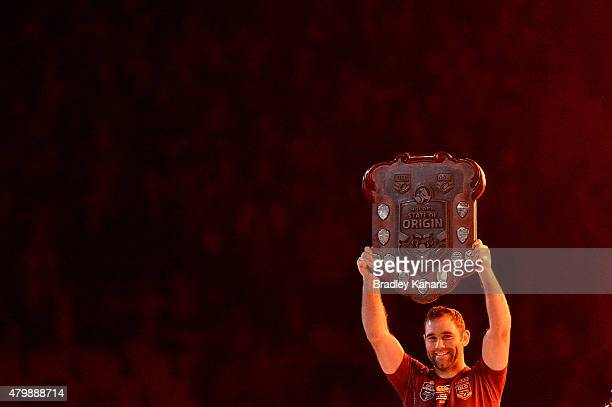 Cameron Smith of the Maroons holds up the winners trophy after game three of the State of Origin series between the Queensland Maroons and the New...