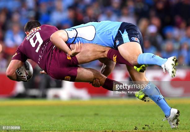 Cameron Smith of the Maroons is picked up by the defence during game three of the State Of Origin series between the Queensland Maroons and the New...
