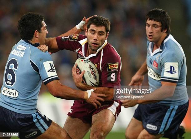 Cameron Smith of the Maroons is tackled by Braith Anasta of the Bluesduring game two of the ARL State of Origin series between the New South Wales...