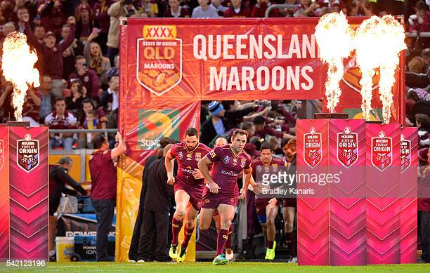 Cameron Smith of the Maroons leads his team onto the field of play during game two of the State Of Origin series between the Queensland Maroons and...
