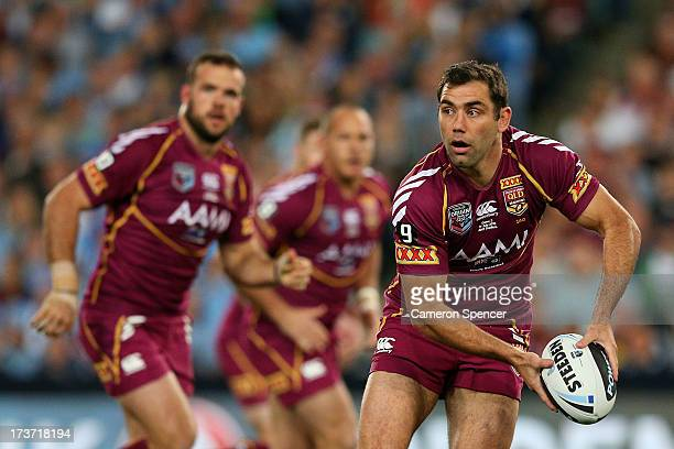 Cameron Smith of the Maroons offloads the ball during game three of the ARL State of Origin series between the New South Wales Blues and the...