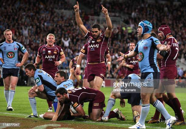 Cameron Smith of the Maroons scores a try as team mates celebrate during game three of the ARL State of Origin series between the Queensland Maroons...