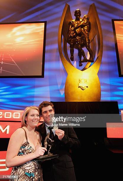 Cameron Smith of the Melbourne Storm and his partner Barb Johnson pose with the Dally M Award medal and trophy after the presentation at the Dally M...