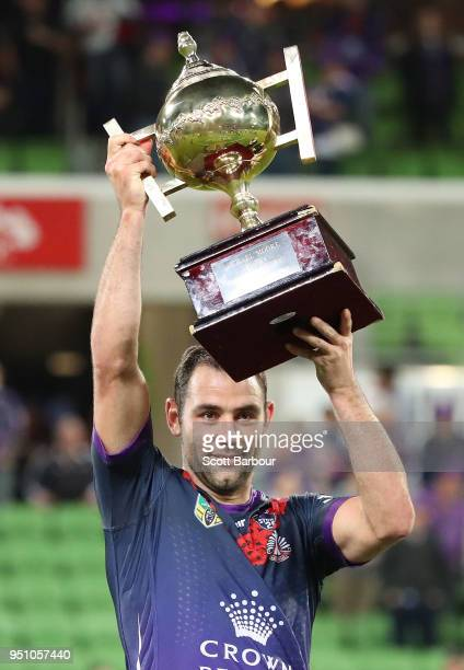 Cameron Smith of the Melbourne Storm holds the Michael Moore trophy after winning the round eight NRL match between the Melbourne Storm and New...