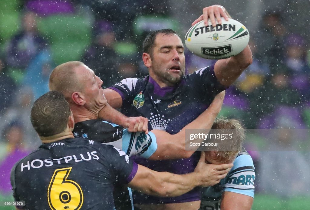 Cameron Smith of the Melbourne Storm is tackled during the round six NRL match between the Melbourne Storm and the Cronulla Sharks at AAMI Park on April 9, 2017 in Melbourne, Australia.