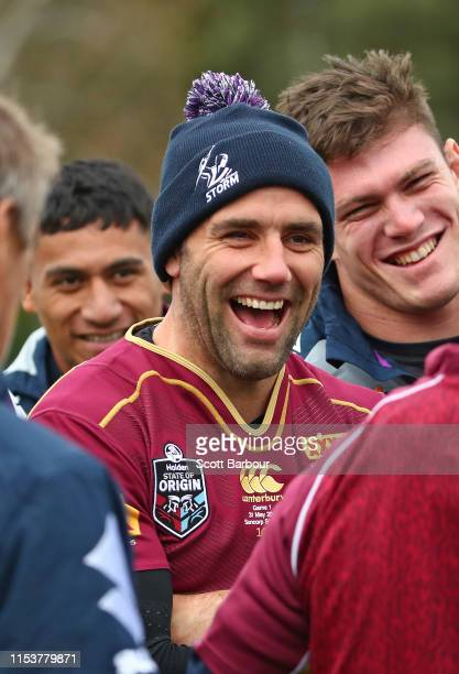 Cameron Smith of the Melbourne Storm laughs as he wears his Queensland Maroons jersey during a Melbourne Storm NRL training session at Gosch's...