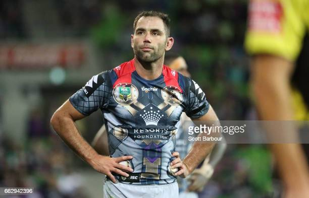 Cameron Smith of the Melbourne Storm looks on as he waits for a decision by the Television Match Official after the final try of the match during the...