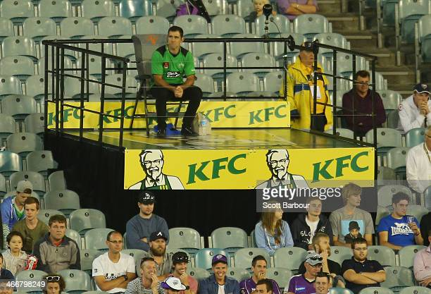 Cameron Smith of the Melbourne Storm looks on from the stand during his role as celebrity catcher during the Big Bash League Semi Final match between...