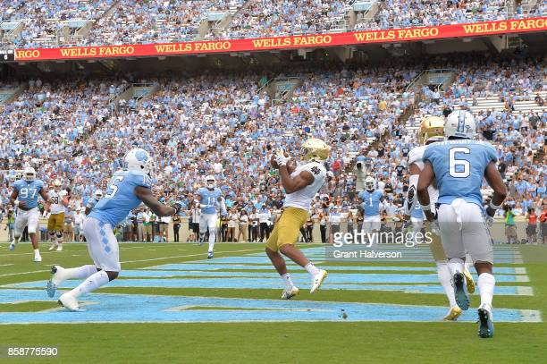 Cameron Smith of the Notre Dame Fighting Irish makes a touchdown catch against the North Carolina Tar Heels during the game at Kenan Stadium on...
