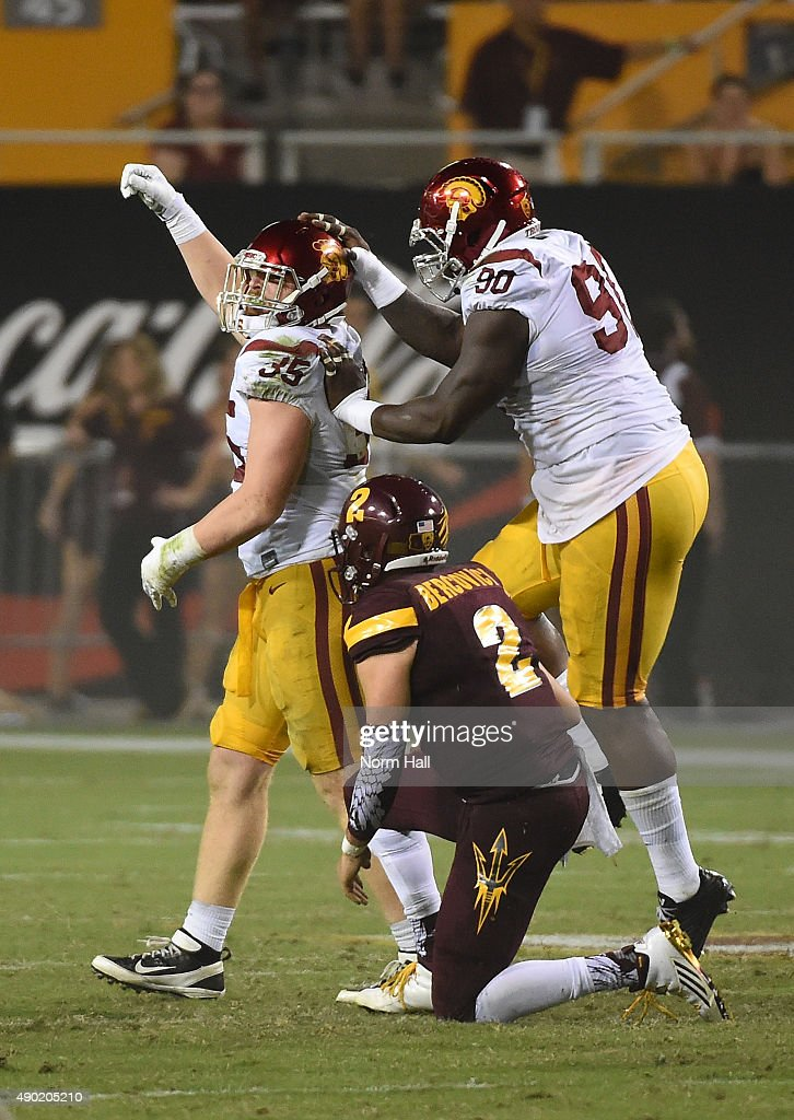 Cameron Smith #35 of the Southern California Trojans celebrates with teammate Claude Pelon #90 after sacking Mike Bercovici #2 of the Arizona State University Sun Devils during the second half at Sun Devil Stadium on September 26, 2015 in Tempe, Arizona. Trojans 42-14.