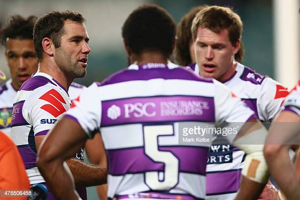 Cameron Smith of the Storm and his team mates look dejected after a Roosters try during the round 12 NRL match between the Sydney Roosters and the...