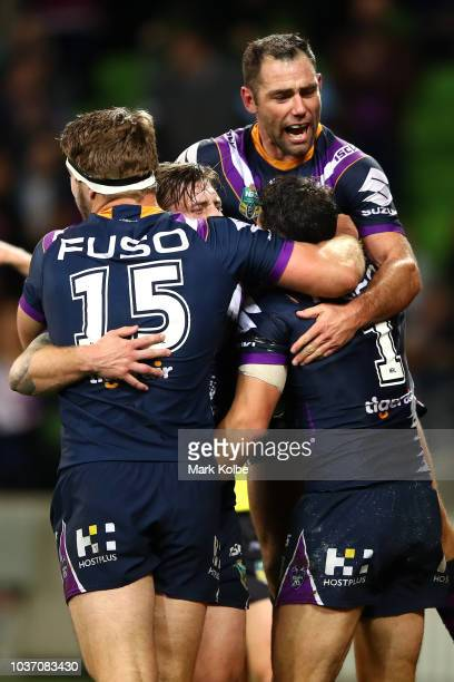 Cameron Smith of the Storm and team mates congratulate Billy Slater of the Storm after scoring a try during the NRL Preliminary Final match between...