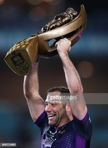 Cameron Smith of the Storm celebrates and holds aloft the NRL Premiership trophy after victory in the 2017 NRL Grand Final match between the...
