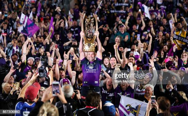 Cameron Smith of the Storm celebrates and holds aloft the NRL Premiership trophy after winning the 2017 NRL Grand Final match between the Melbourne...