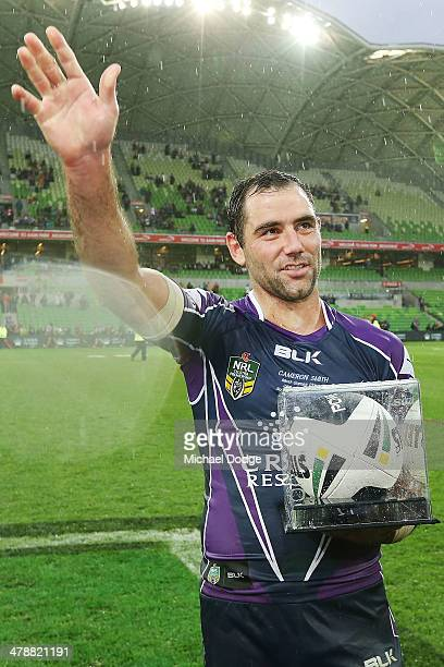 Cameron Smith of the Storm celebrates his win in his club record 263rd game during the round two NRL match between the Melbourne Storm and the...
