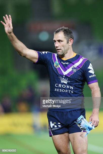 Cameron Smith of the Storm celebrates the win with fans during the round three NRL match between the Melbourne Storm and the North Queensland Cowboys...
