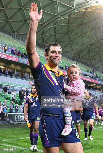 Cameron Smith of the Storm celebrates the win with his kids during the round 14 NRL match between the Melbourne Storm and the Newcastle Knights at...