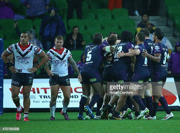 Cameron Smith of the Storm celebrates with team mates after scoring a field goal during the round seven NRL match between the Melbourne Storm and the...