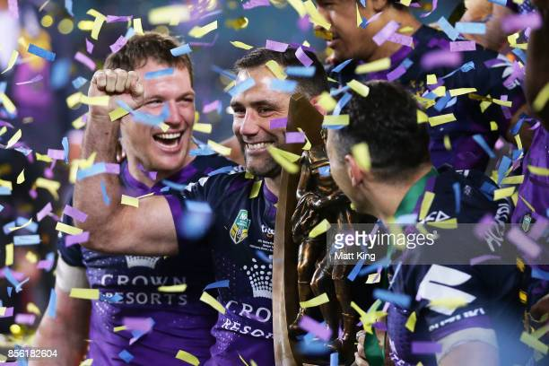 Cameron Smith of the Storm celebrates with team mates and holds aloft the NRL Premiership trophy after victory in the 2017 NRL Grand Final match...