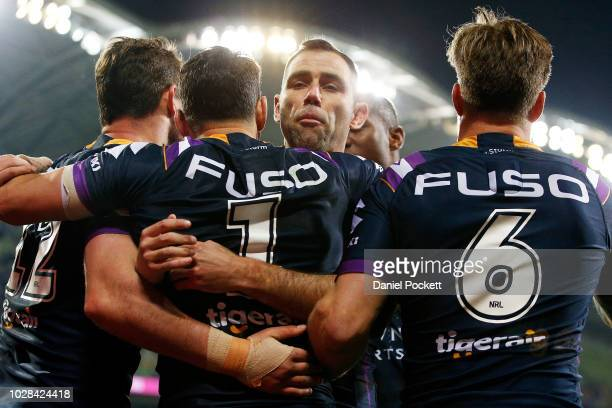 Cameron Smith of the Storm celebrates with teammates during the NRL Qualifying Final match between the Melbourne Storm and the South Sydney Rabbitohs...